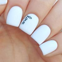 Picture Of white nails with letters written with a sharpie