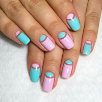 Picture Of bold blue and pink half moon nails for summer