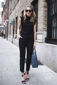 Picture Of a black jumpsuit with a high neckline, ruffled ...