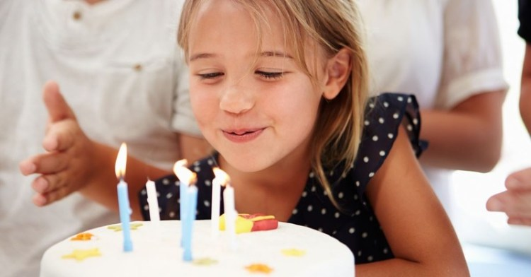 little girl blowing out birthday candles prayer