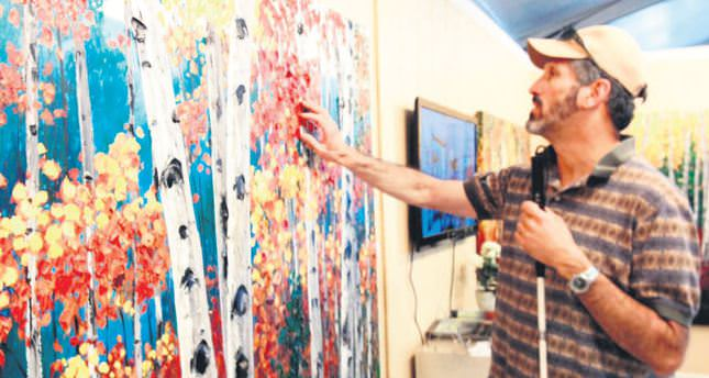 Turkish painter offers hands-on art experience for the blind