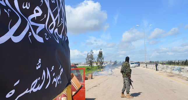 Members of al-Qaidas Nusra Front man a checkpoint in Idlib (March 2015) (Reuters Photo)