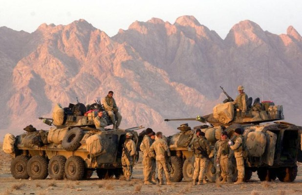 US Marines begin to form up their convoy at a staging area near Kandahar, as they await orders to begin their trek to Kandahar to take control of the airfield, December 13, 2001. [Photo: Reuters]