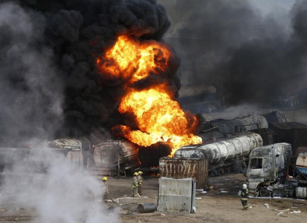 Smoke and flames rise from fuel trucks after an overnight attack by the Taliban on the outskirts of Kabul, July 5, 2014. [Photo: Reuters]