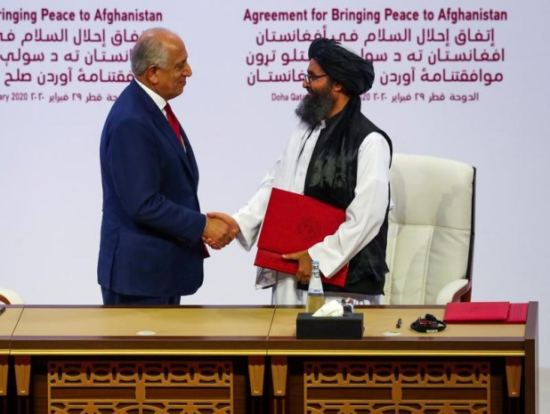 Mullah Abdul Ghani Baradar, the leader of the Taliban delegation, and Zalmay Khalilzad, US envoy for peace in Afghanistan, shake hands after signing an agreement at a ceremony between members of Afghanistan's Taliban and the US in Doha, Qatar February 29, 2020. [Photo: Reuters]