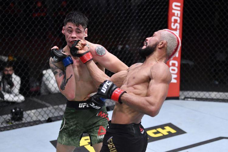 Despite landing power shots regularly, Brandon Moreno managed to withstand Figueiredo's freakish knockout power   UFC 263   Pintsized Interests
