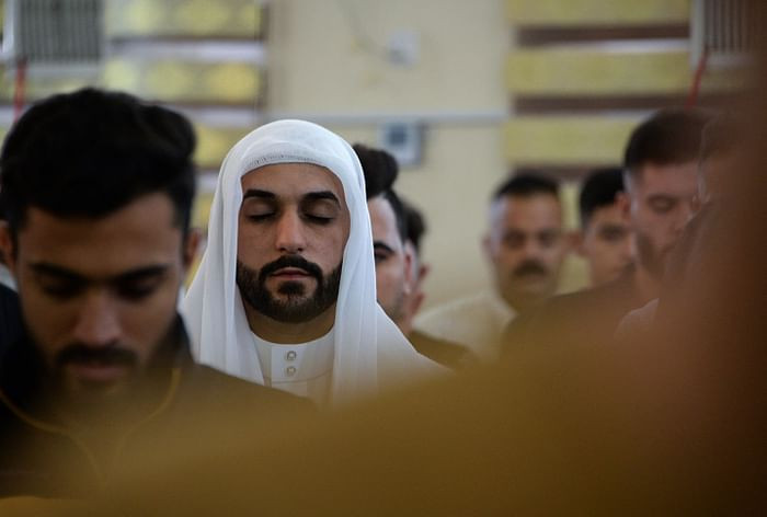 Iraqi worshippers perform the Eidul Azha prayers on the first day of the feast celebrated by Muslims worldwide, at the Mohammed Alamine mosque in the northern city of Mosul, on July 20, 2021. PHOTO: AFP