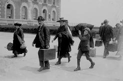 Ellis Island: Immigrants have just landed and are headed for the island's main building.