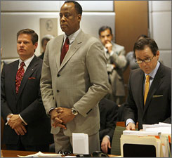 Another former Michael Jackson employee is alleging that Dr. Conrad  Murray, seen here during a February 8th court appearance, stopped CPR  on the singer in order to remove drug vials from the scene.