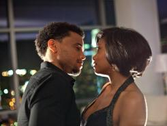Battle of the sexes: Michael Ealy and Taraji P. Henson star as one of the couples trying to get the upper hand in their relationship via Steve Harvey's dating tome in 'Think Like a Man.'