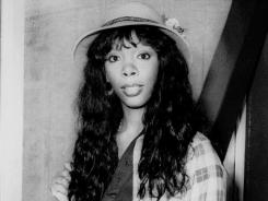 Donna Summer, then 27, arrives at Heathrow Airport from Paris in 1977. The queen of disco died Thursday at age 63.
