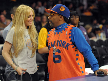 Lohan chats with Spike Lee before the start of the Knicks/Lakers game.
