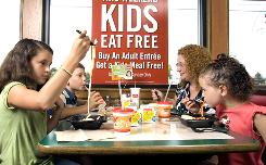 Madeleine, 12, left, Brian, 8, and Olivia, 7, eat free at a Fazoli's in Ohio with mom, Melissa Rapp.