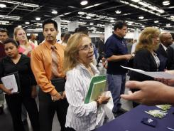 Maria Wilt, center, talks to a recruiter at a job fair expo in Anaheim, Calif., in June 2012.