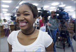 "Alexis Yarger, 16, is all smiles after officials from her school district in Georgia announced the new ""learn and earn"" program, in which students will get paid for attending tutoring sessions."