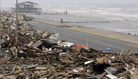 A biker rides along a portion of the sea wall that had been cleared of debris from Hurricane Ike in Galveston, Texas, on Saturday.