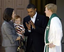 Sen. Barack Obama talks with married pastors Katherine and Lars Olson and son Carl Olson, 11 months, after attending church at St. Lukes Lutheran Church in Lima, Ohio.
