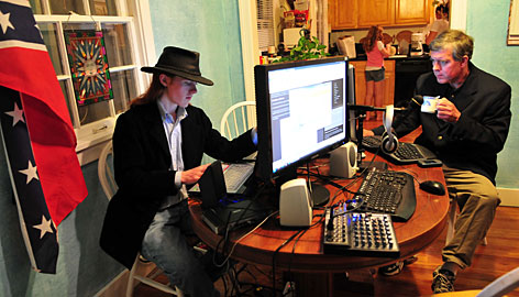 Derek Black, left, gets help from his father, Don, on his Internet radio show Sunday in Lake Worth Fla. Don Black is a former Ku Klux Klan leader, and Derek holds a seat on the Palm Beach County, Fla., GOP committee.