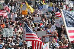 Protesters rally April 15 at the Capitol in Lansing, Mich., as part of a series of protests that spanned the USA.