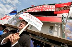 Gary Cozette protests outside Wrigley Field before the start of the Cubs' game against the Arizona Diamondbacks on Thursday in Chicago. Dozens of people demonstrated outside the park calling for a boycott of the series to protest the passage of Arizona's controversial new immigration law.
