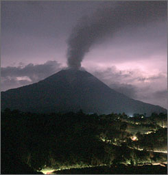 An image shows a plume of volcanic ash rising from the crater of Mount Sinabung as seen from Tanah Karo district in North Sumatra province about two hours before its eruption.