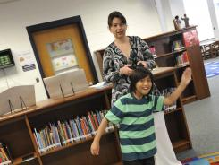 Technology resource teacher Adina Popa works with student Michael Mendoza using the Xbox Kinect. Motion sensors have become a big deal in the world of autism therapy and education.