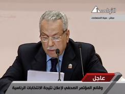 Judge Farouk Sultan, chairman of Egypt's election committee, announces the results of the presidential election Saturday in Cairo.