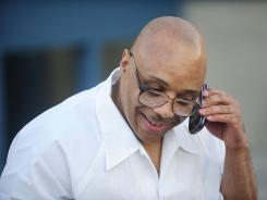 Andre Davis speaks with his mother on a cell phone outside the Tamms Correctional Center after being released on Friday in Tamms, Ill.