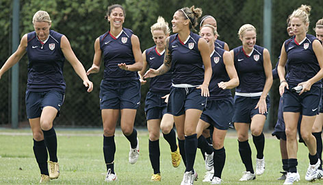 Members of the USA women's soccer team jog during practice on Saturday. Embattled goalkeeper Hope Solo was not present.