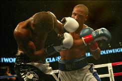 Andre Ward, right, throws a right hand at a reeling Allan Green during their Super Six bout at Oracle Arena.