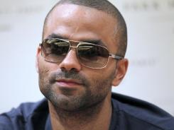 San Antonio Spurs guard Tony Parker has recovered enough from an eye injury suffered as a bystander to a fight at a New York City bar to be able to play for France in the London Olympics. The bar is set to reopen Tuesday.