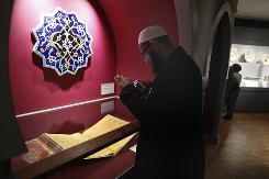 Imam Sohel Mangera photographs a Qur'an from about 1450-60 displayed at the Detroit Institute of Art.