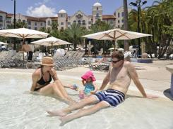Scott and Jennifer Van Timmeren and daughter Brynn of Grand Rapids, Mich., at the pool of the Hard Rock Hotel at Universal Orlando Resort.