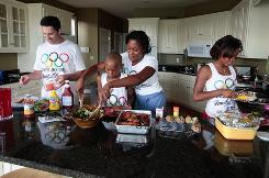 Family cooking and exdercising together