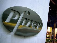 Two key late-stage studies of Pfizer's blockbuster pneumococcal vaccine for children show it works at least as well as a rival in adults, a big market the drugmaker wants to tap.