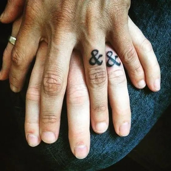 Ampersand wedding ring tattoos are a creative idea for wedding tattoos like no other