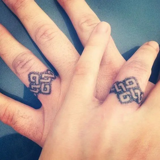 Bold tribal wedding ring tattoos for those who love such patterns for real