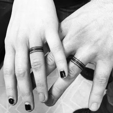 Chic wedding ring tattoos imitating real bands with just three lines