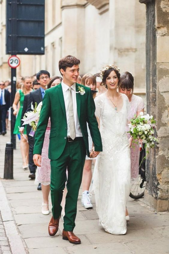 an emerald wedding suit with a grey tie, white shirt and brown shoes for a retro-inspired groom's look