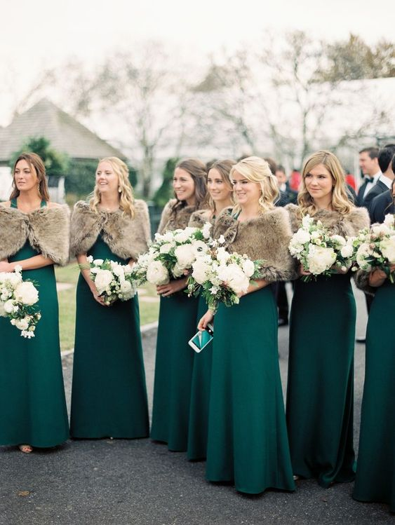 emerald maxi bridesmaid dresses with a fau fur coverup is a gorgeous idea for fall or winter