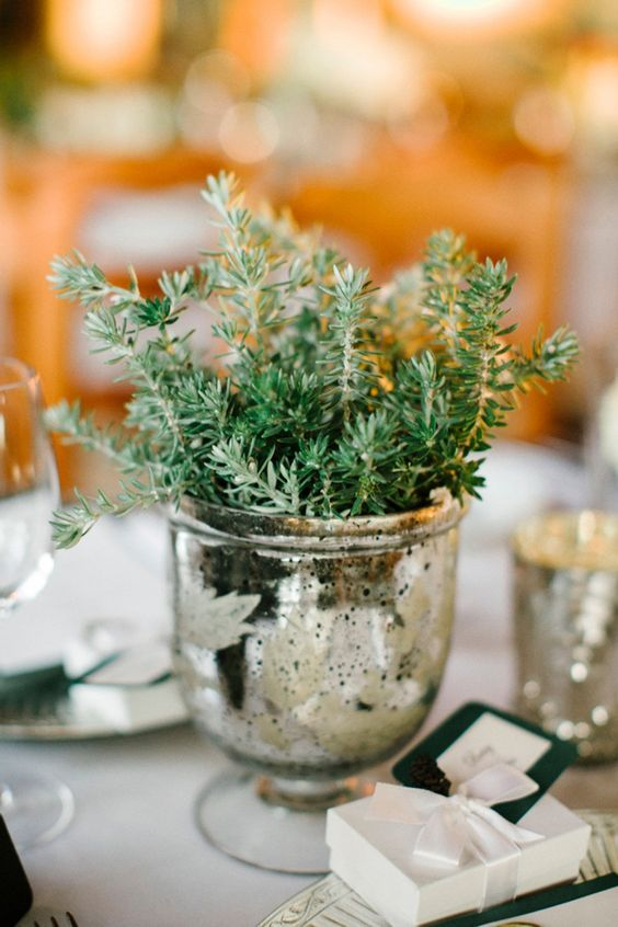 a mercury glass urn with greenery is a chic and simpel centerpiece idea