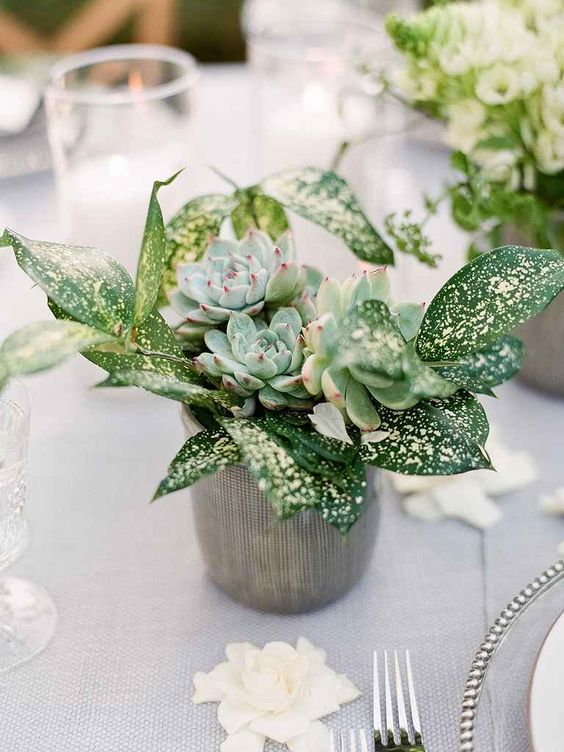 a wedding centerpiece with greenery and succulents is a chic and trendy decor idea