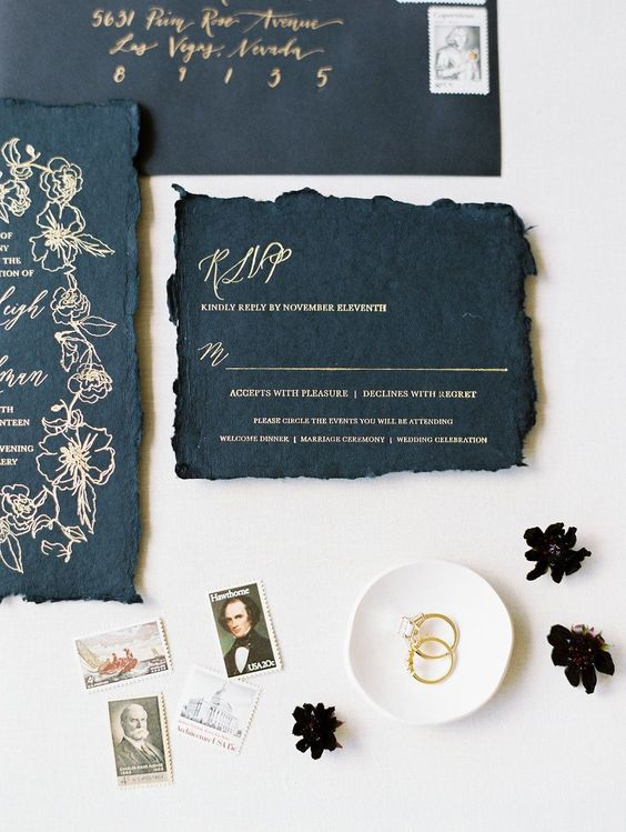 black wedding invites with a raw hem and gold calligraphy are perfect for a gothic wedding
