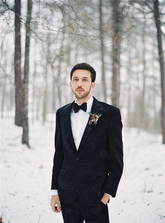 a black velvet tux plus a white button down is a gorgeously elegant look that will keep you warm