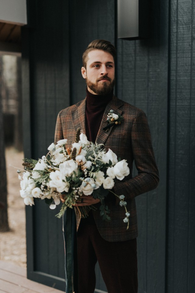 burgundy velvet pants and a matching turtleneck, a brown plaid blazer and a boutonniere for a casual winter groom's look