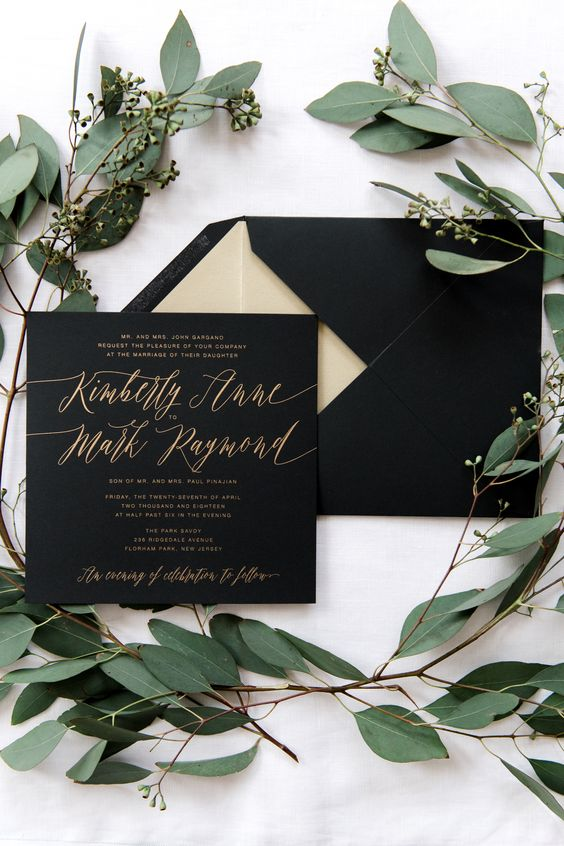 black and gold wedding invitation suite with calligraphy is a very elegant option