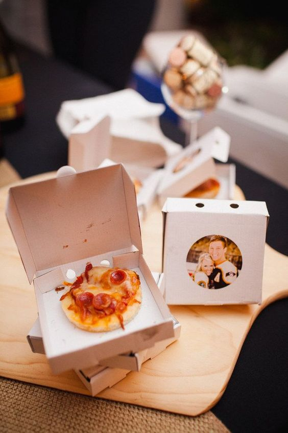 mini pizzas in boxes with the couple's photos are a great and personalized late night snack idea