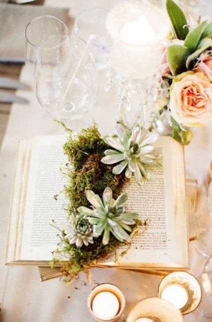 an open book with moss and succulents is a cool idea for a book lover wedding