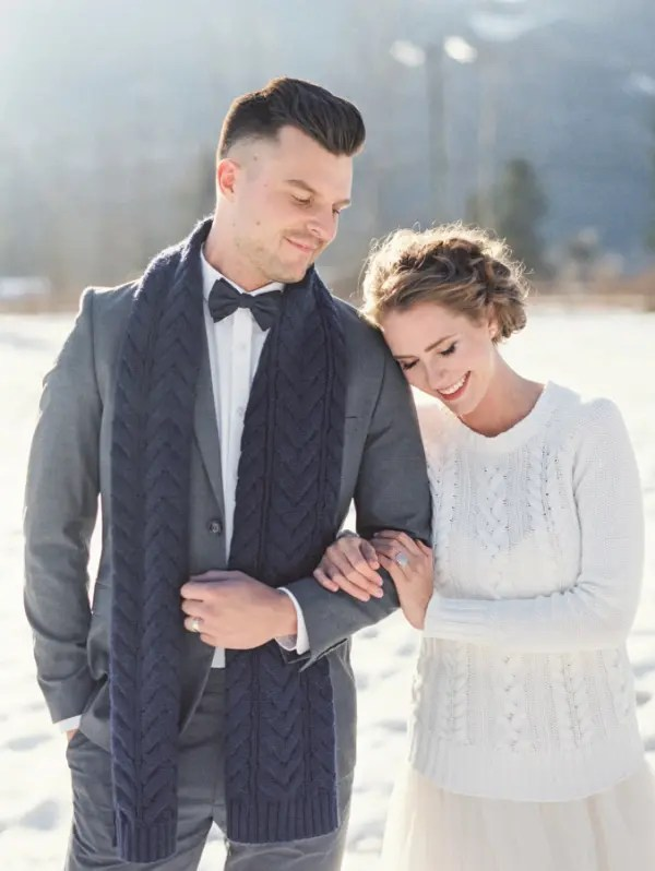 a white cable knit bridal sweater and a navy cable knit scarf to tie up your couple look
