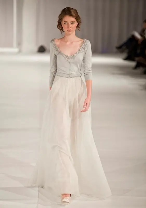 a grey cut out embellished cardigan and a neutral skirt for a chic and refined bridal outfit
